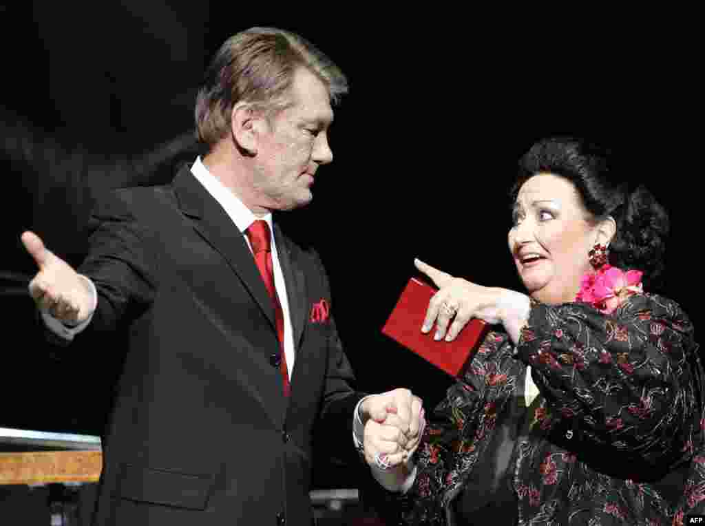 Ukrainian President Viktor Yushchenko (left) invites Montserrat Caballe on stage before her concert in Kyiv on April 20, 2006, where he awarded her the Ukrainian medal of Princess Olga of the First Degree for her contributions to the opera world.