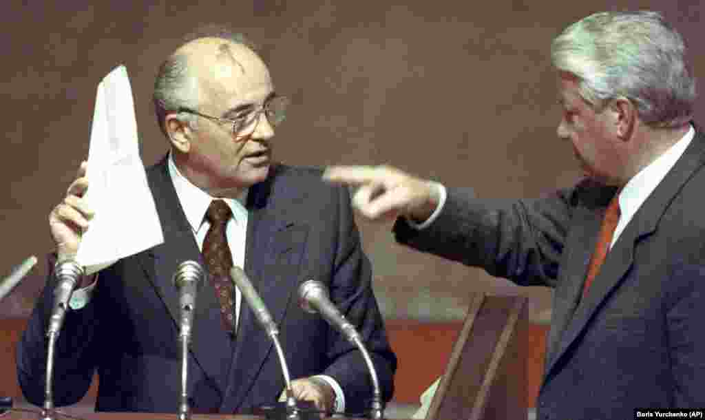 A moment of humiliation: Following the failed coup against him, Gorbachev is forced by Russian President Boris Yeltsin to read out a list of plotters at an extraordinary session of the Russian Supreme Soviet in Moscow on August 23, 1991.