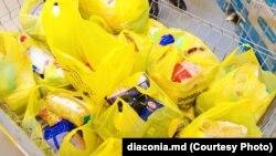 """O campanie de colectare a produselor alimentare organizată de Misiunea socială """"Diaconia"""" a Mitropoliei Basarabiei. Imagine de arhivă"""