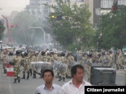 Iranian riot police patrol a street in Tehran, during protests of supporters of Mahmoud Ahmadinejad's opposing candidate Mir Hossein Musavi, Tehran, June 2009
