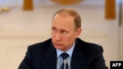 Russian President Vladimir Putin said a new agency should be set up to implement Russia's policy in the region.