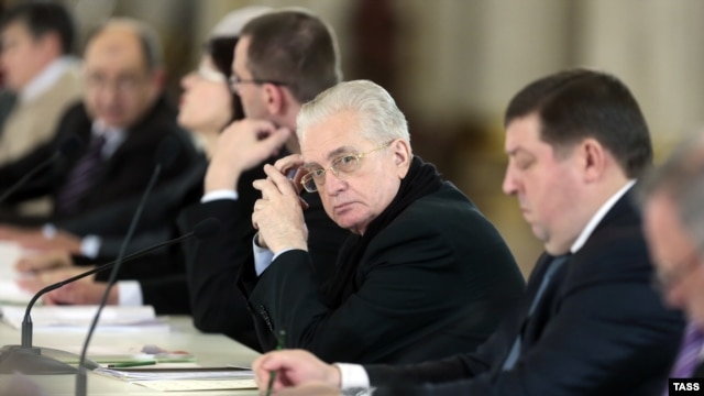 """Hermitage Museum director Mikhail Piotrovsky (center) says art attacks shows that Russian society is """"sick."""""""