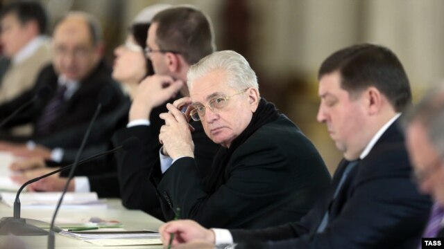 "Hermitage Museum director Mikhail Piotrovsky (center) says art attacks shows that Russian society is ""sick."""