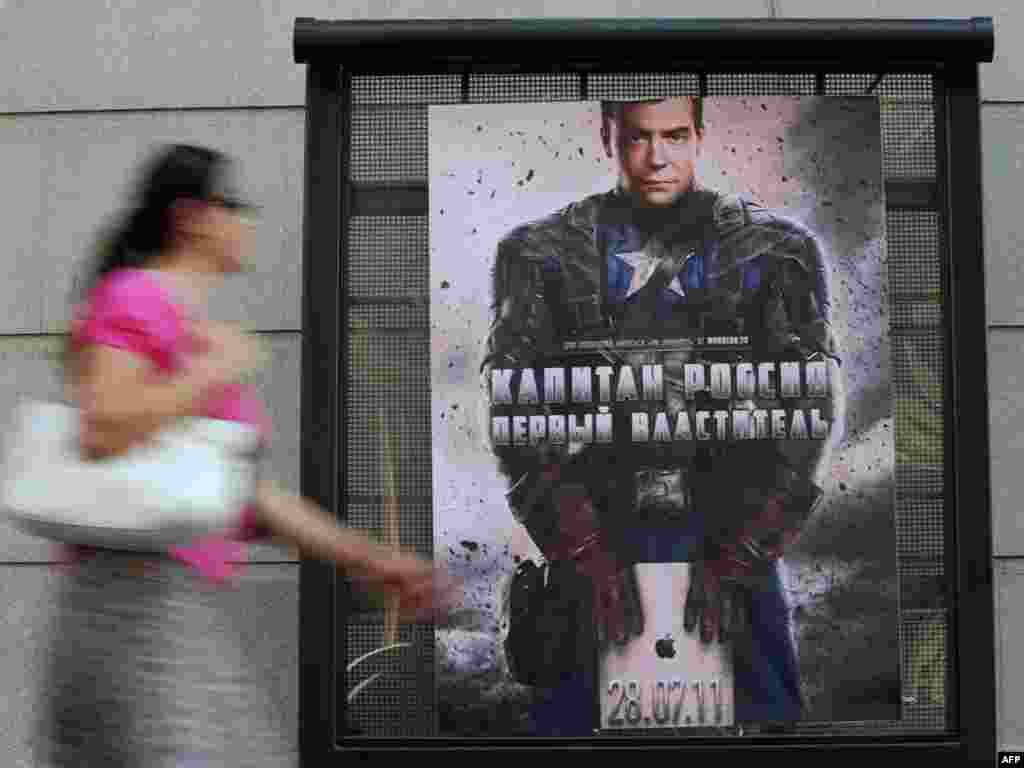 "A woman passes a mysterious poster depicting Russian President Dmitry Medvedev in a ""Captain America"" costume with the words ""Captain Russia , the first Lord"" in central Moscow on July 26. Photo by Natalia Kolesnikova for AFP"