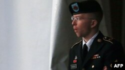 Private First Class Bradley Manning is escorted from a hearing in Fort Meade, Maryland in January.
