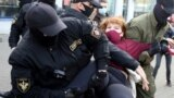 Belarus - Anti-riot police officers detain and arrest a woman demonstrating during a rally to protest against the presidential election results in Minsk, 19sep2020