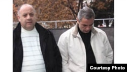 Armenia -- Tigran Grigorian (R), the arrested head of the State Ecological Inspectorate, is taken to a Yerevan court on December 30, 2009. (Photo courtesy of Gagik Shamshian.)