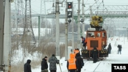 Investigators at the site of the blast on a railway line near Russia's second-largest city, St. Petersburg, on February 2..