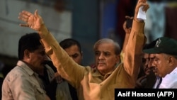 FILE: Shahbaz Sharif (C), the younger brother of ousted Pakistani prime minister Nawaz Sharif and the head of Pakistan Muslim League -Nawaz (PML-N), waves to supporters during an election campaign meeting in Karachi, June 2018.
