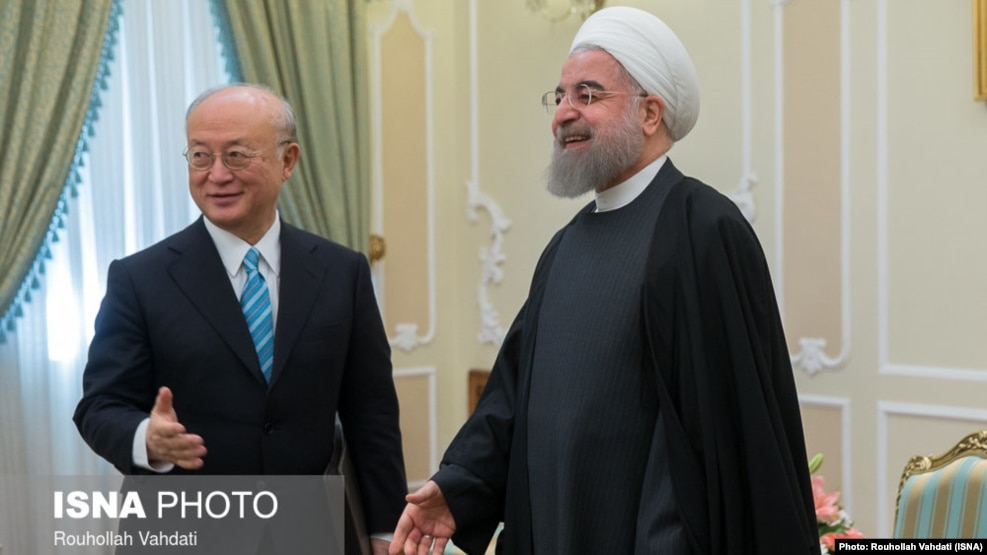 Iranian President Hassan Rohani (right) meets with UN nuclear chief Yukiya Amano in Tehran on December 18.
