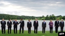 Heads of state and government pose for the family picture at the G8 summit in Huntsville, Ontario on the first day of the gathering.