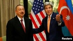 Austria - U.S. Secretary of State John Kerry (R) gestures next to President Ilham Aliyev of Azerbaijan during a bilateral meeting in Vienna, Austria, May 16, 2016