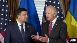 U.S. Vice President Joe Biden (right) speaks with Ukrainian Prime Minister Volodymyr Hroysman during the latter's visit to Washington this week.