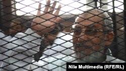 المرشد العام لجماعة الأخوانالمسلمين أثناء جلسة محاكمة في القاهرة