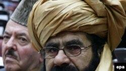 Президент Карзай сунуш кылган талапкерлерди бекитүү Парламенттин колунда. Ооган депутаттар. 9-январь 2009Parliamentarians attend an assembly session in Kabul, 09Jan2009