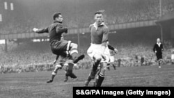 Chelsea's Reg Williams (right) rushes in to challenge Dynamo Moscow's Ivan Stankevich (left), deflecting the ball into the net for Chelsea's second goal, making the score 2-0.
