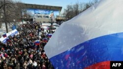 Members of the pro-Kremlin youth groups take part in a rally in Moscow's Pushkin Square on March 11 to mark the upcoming 2012 presidential election.