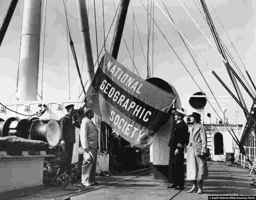 "The National Geographic Society flag unfurls aboard a prewar Noah's ark: The ""M.S. Silverash"" carried the society-supported Mann Expedition to the East Indies in 1937 to collect exotic animals for the National Zoo in Washington."