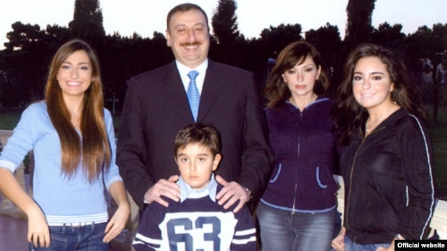 Azerbaijani President Ilham Aliyev (second from left) and members of his family have been linked to money placed in offshore accounts. (file photo)