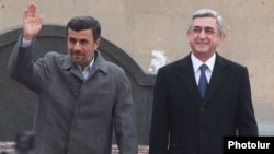 Armenia - President Serzh Sarkisian (R) meets his visiting Iranian counterpart Mahmud Ahmadinejad in Yerevan,23Dec2011.