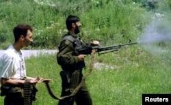 Serbs advancing on positions near Srebrenica in July 1995.
