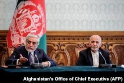 Afghan President Ashraf Ghani (right) and his main political rival, Chief Executive Abdullah Abdullah.
