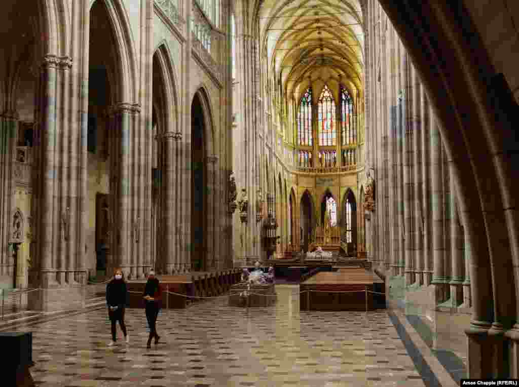 Two Czechs walk through the silent cathedral. Most visitors RFE/RL spoke to were Czechs from Prague or other parts of the country.