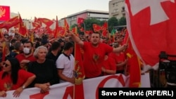 Protesters in Podgorica wave national flags to protest the use of Serbian national symbols by opposition parties that preliminary results show won elections last week.