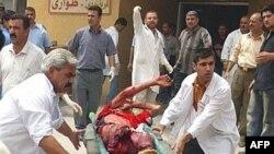 بیش از بیست و یک نفر در اثر انفجار های انتحاری روز چهارشنبه بغداد کشته شده اند