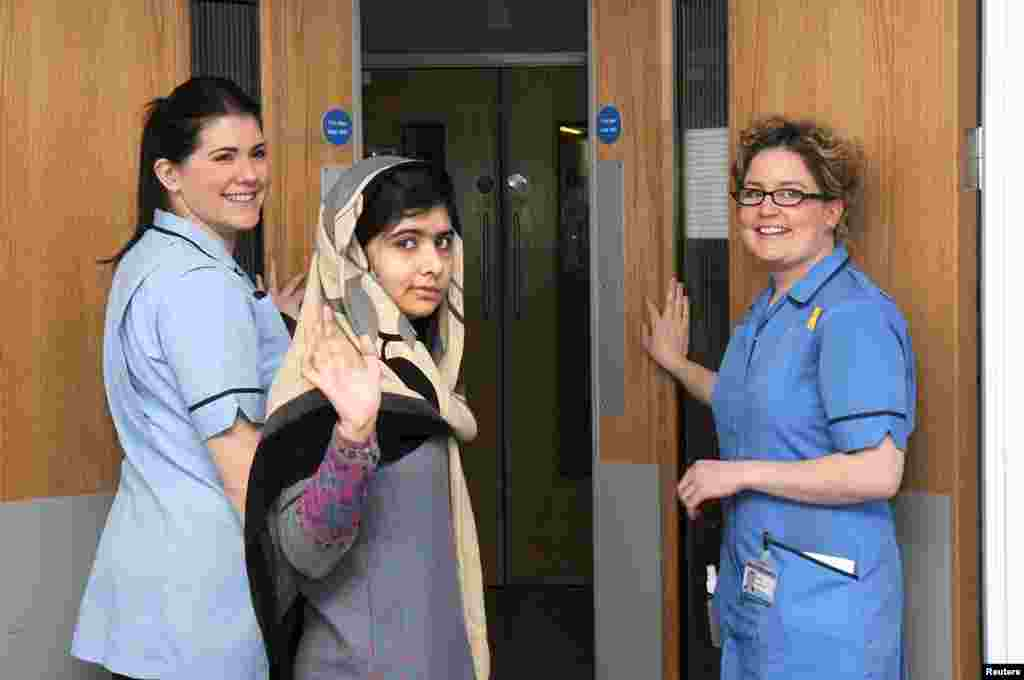 Pakistani schoolgirl Malala Yousafzai waves as she is discharged from the Queen Elizabeth Hospital in Birmingham, England. Malala, 15, was shot in the head by the Taliban for advocating girls' education. Doctors said she was well enough to spend some time recovering with her family. She is due to be readmitted in late January or early February for reconstructive surgery to her skull. (Reuters)