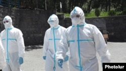 Armenia -- Healthcare workers wearing protective gear are seen outside the Nork Hospital for Infectious Diseases, Yerevan, June 5, 2020.