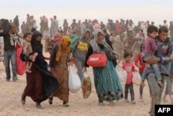 Беженцы из Сирии, покинувшие свои дома из-за нападений исламистов. 4 мая 2016 года.