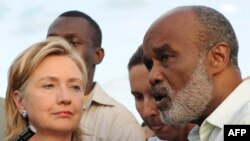 Haitian President Rene Preval (right) speaks to the press with U.S. Secretary of State Hillary Clinton after their meeting at Port-au-Prince's airport on January 16.