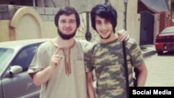 Chechen Islamic State militant DjunduLlah (right) poses with a fellow militant in photo posted to his ask.fm account. DjunduLlah complains that there are no women for him to marry.