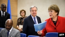 UN Secretary-General Antonio Guterres (C) and United Nations High Commissioner for Human Rights Michelle Bachelet (R) arrive at the opening day of the 40th session of the United Nations (UN) Human Rights Council on February 25, 2019 in Geneva. (Photo by F