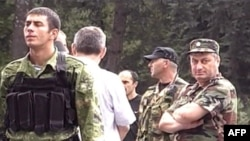 South Ossetian leader Eduard Kokoity (right) outside Tskhinvali on August 7