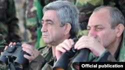 Nagorno-Karabakh - Armenian President Serzh Sarkisian (L) watches military exercises in Nagorno-Karabakh.