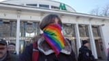 A transgender rights activist stands in a park for a rally on November 18. Organizers were forced to abandon the event after far-right counterdemonstrators assaulted several protesters and attacked a Canadian journalist.