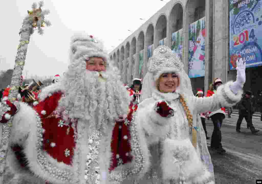 Father Frost (left) and his granddaughter the Snowmaiden take part in a New Year's parade in Bishkek, Kyrgyzstan, on December 31. (epa/Igor Kovalenko)