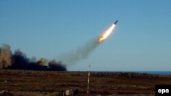 A Russian cruise missile is test-fired over the Barents Sea.