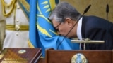 Kazakhstan - Acting President of Kazakhstan Kassym-Jomart Tokayev kisses a flag as he takes part in a swearing-in ceremony during a joint session of the houses of parliament in Astana, Kazakhstan March 20, 2019. Kazakh Presidential Press Service/Handout v