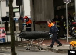 Medical personnel remove the body of a victim from the Maalbeek subway station on March 23, a day after the attacks.