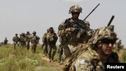 U.S. soldiers patrol with Afghan National Army soldiers in the Zharay district, Kandahar Province.