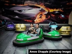 Young twins strap in for a bumper car ride inside a shopping center in the capital, Ashgabat.