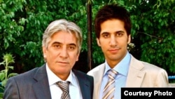Iranian asylum seeker Yashar Khameneh (right) with his father, who he says has been imprisoned over his son's Internet activities