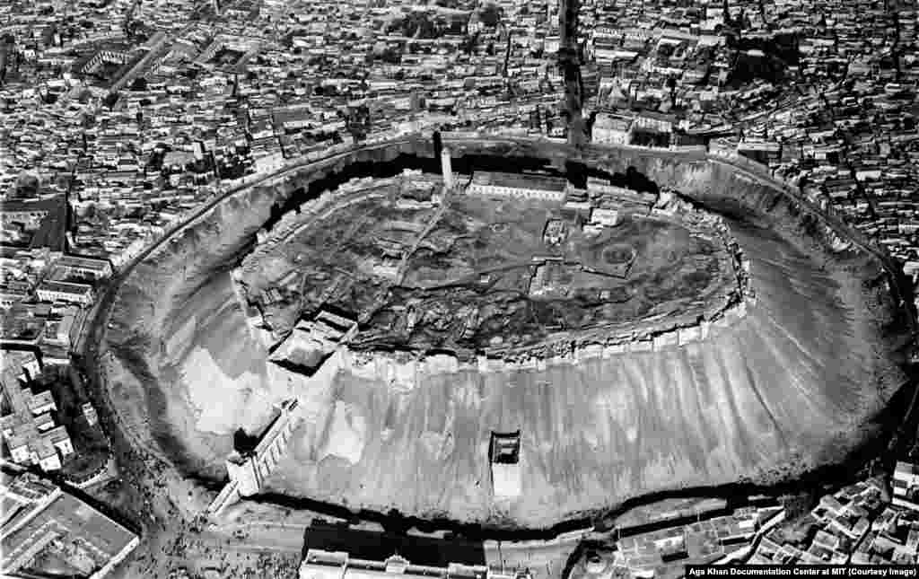 "Aerial view of Aleppo's Citadel, photographed in 1937. When writer Gertrude Bell visited the famous trading town in 1907, she likened it to ""a cup and saucer, the houses lie in the saucer and the [Citadel] sits on the upturned cup."""