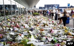 Bouquets in tribute to the victims at Amsterdam's Schiphol airport shortly after the tragedy. Almost 200 of the 298 people killed in the disaster were Dutch nationals.