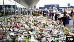 Bouquets of flowers in tribute to the victims of the downed Malaysia Airlines flight MH17 on July 25, 2014, at Schiphol airport near Amsterdam.