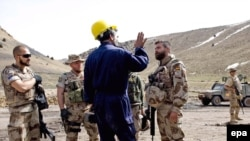 Spanish soldiers of NATO's International Security Assistance Force (ISAF) visit a coal-mining camp in Herat in March.