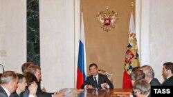Russian President Dmitri Medvedev (center) presides over meeting on economic issues in the Kremlin on September 18.